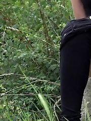 15 pictures - Outdoor pissing for hot babe in black denims