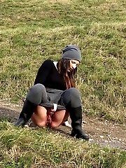 15 pictures - Dark haired babe pisses in the countryside