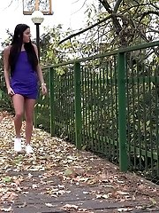 15 pictures - Gorgeous raven haired girl pisses on wooden path