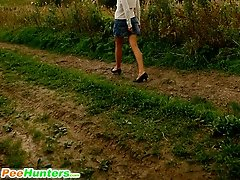 16 pictures - Babe tinkles on a road in the middle of a field