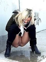 15 pictures - Cute blonde pees in the middle of the city