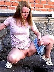 15 pictures - Gorgeous blonde is filmed peeing in public