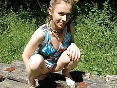 16 pictures - See hot teeny pissing onto her dad's picnic table