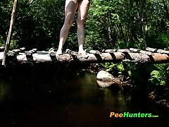 16 pictures - Charming red-haired teen cutie pees off the bridge