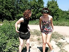 16 pictures - Two charming young girls pee next to each other
