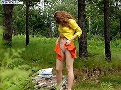 16 pictures - Raunchy babe gets stripped and pisses in the woods