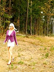 16 pictures - Blonde with tattooed legs pees near forest edge