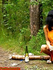 16 pictures - Sexy brunette peeing in the park road