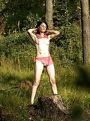 16 pictures - Naughty smoking girl takes a leak in the woods