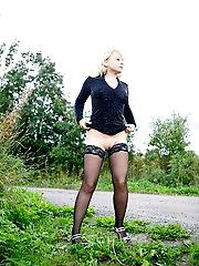16 pictures - Stockinged blonde makes water on a quiet park alley