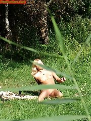 16 pictures - Blonde teen pissing in the park