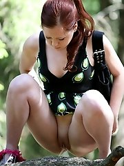 16 pictures - Cute young redhead got busted pissing in the woods