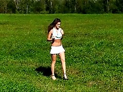 4 movies - Sweet cheerleader takes a quick leak at the field