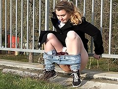 0  - Gorgeous girl squats and pees over the grass