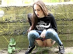 0  - Pretty brunette relieves herself by pissing