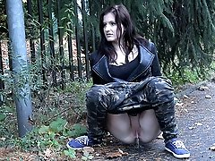0  - Sexy girl in camouflage trousers pisses outside