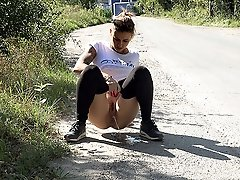 0  - Pretty babe pees while a lorry drives past