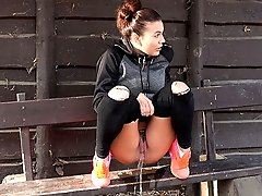 0  - Outdoor pissing for pretty brunette fitness fan