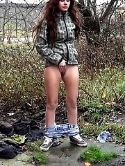 15 pictures - Brunette is filmed in a pee fail wetting her panties