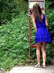 15 pictures - Pretty brunette pees next to a bus stop