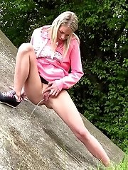 15 pictures - Public pissing for cute blonde European