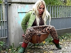 1 movies - Cute blonde in leopard print leggings pisses