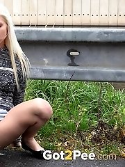 15 pictures - Gorgeous blonde is desperate to piss outside