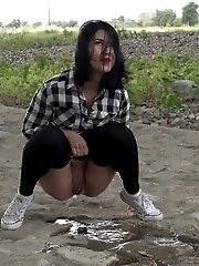 15 pictures - Exotic babe squats to piss near main road