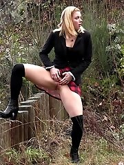 15 pictures - Cute girl in plaid skirt and blazer pisses outside