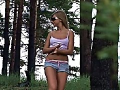 4 movies - Slim swarthy blonde caught urinating under a tree