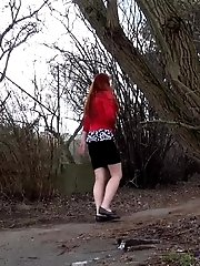 15 pictures - Stunning redhead stands to piss outside