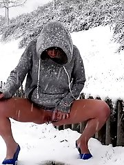 15 pictures - Sexy girl melts snow as she pisses outside