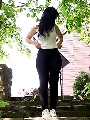 15 pictures - Dark haired babe pisses down stone steps