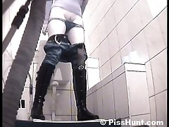 14 pictures - Blonde get unlucky to pee in spycammed toilet