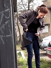 15 pictures - Sexy brunette babe pisses behind a bus stop