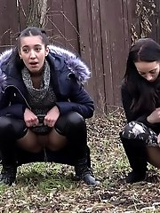 15 pictures - Dark haired European babes piss in public