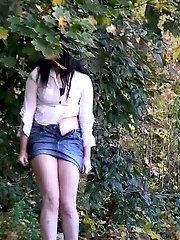 15 pictures - Sexy raven haired girl pisses in the leaves