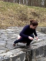 15 pictures - Antonia pees outside next to drainage pipe