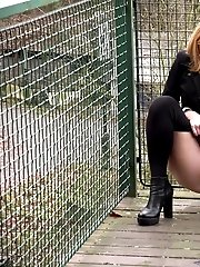 15 pictures - Blonde in pantyhose pisses on wooden decking