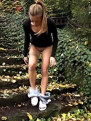 15 pictures - Pretty European gushes her piss while outside